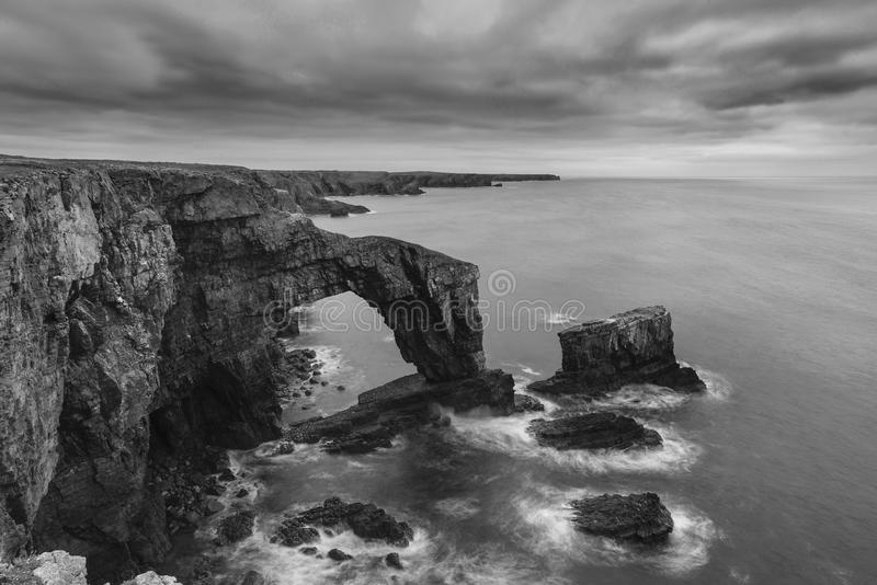 Beautiful black and white landscape image of Green Bridge of Wa royalty free stock photo