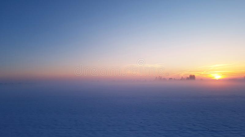 Beautiful sunset in blue light royalty free stock photo