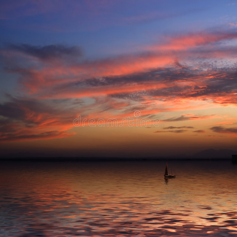 Beautiful sunset and a Boat royalty free stock photography
