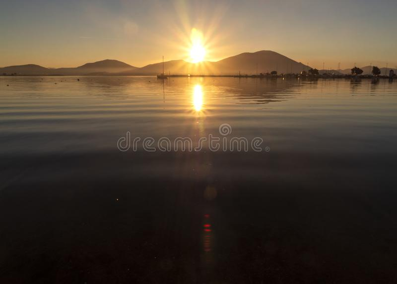 Beautiful sunset on the calm Aegean Sea on the island of Evia, Greece royalty free stock photo