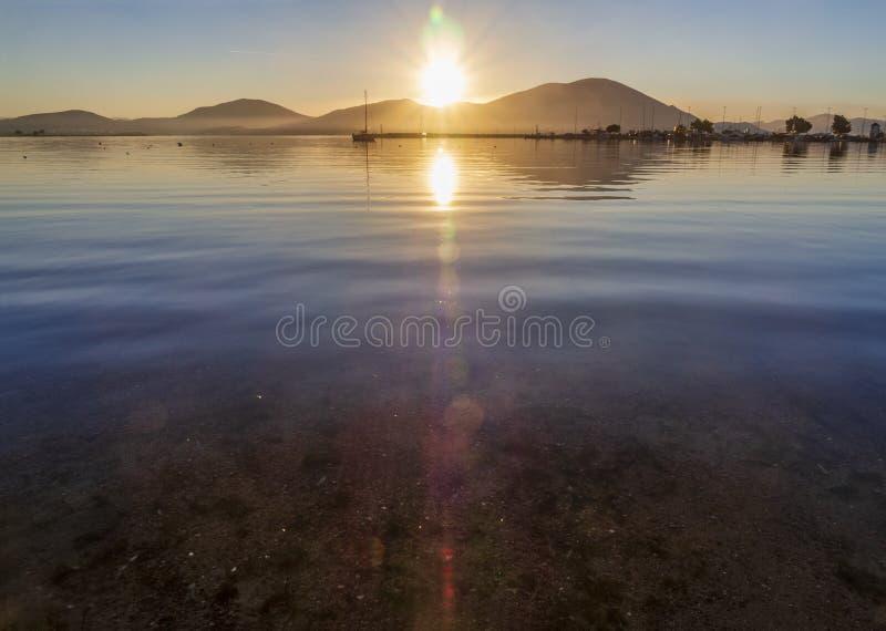 Beautiful sunset on the calm Aegean Sea on the island of Evia, Greece stock image