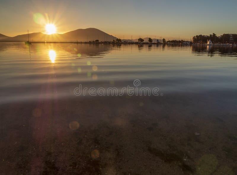 Beautiful sunset on the calm Aegean Sea on the island of Evia, Greece royalty free stock image