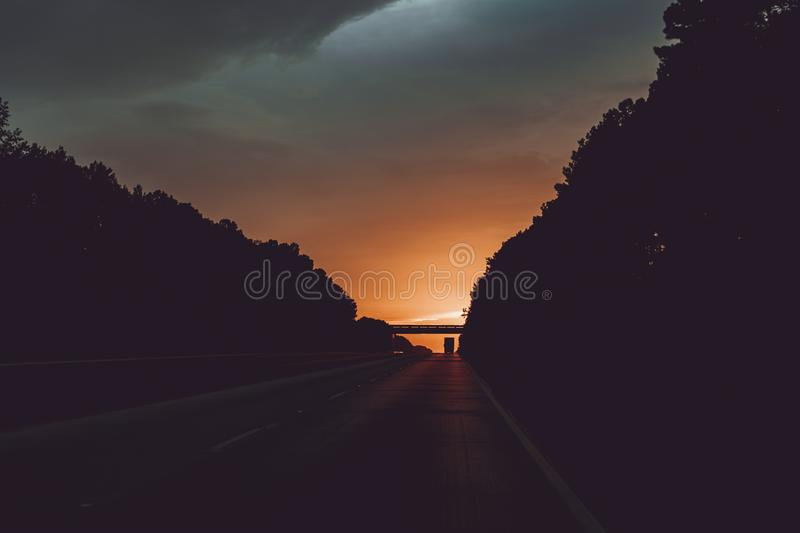 Beautiful sunset captured from a half-empty highway royalty free stock images