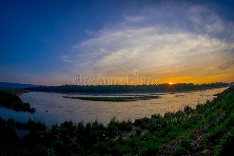 Beautiful sunset in Chitwan National Park, is mainly covered by jungle, fish eye effect stock images