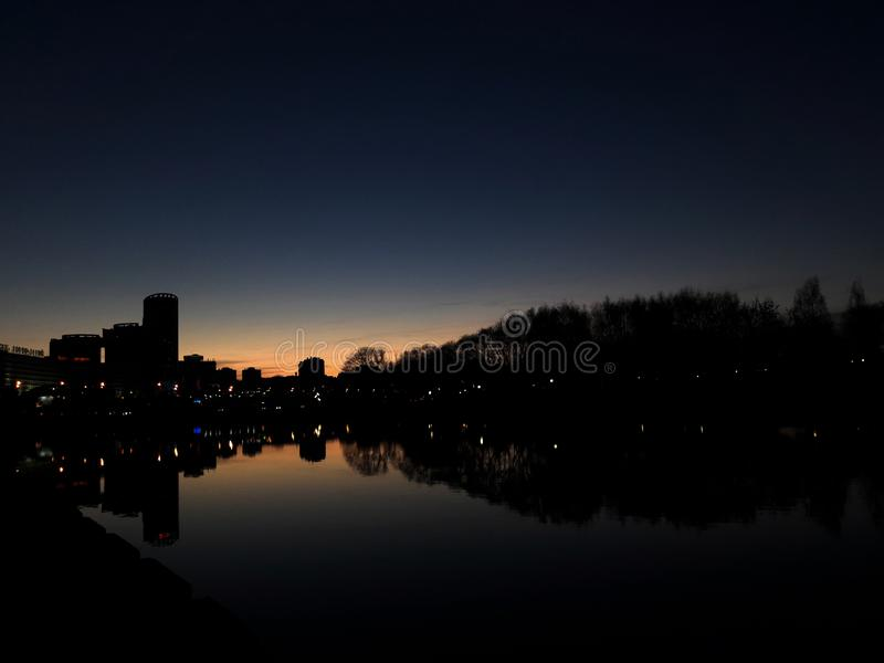 Beautiful sunset in the city. River. royalty free stock photo