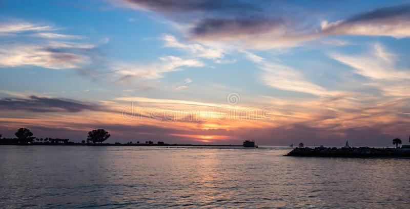 Beautiful sunset in clearwater beach. With blue and orange colors stock photos