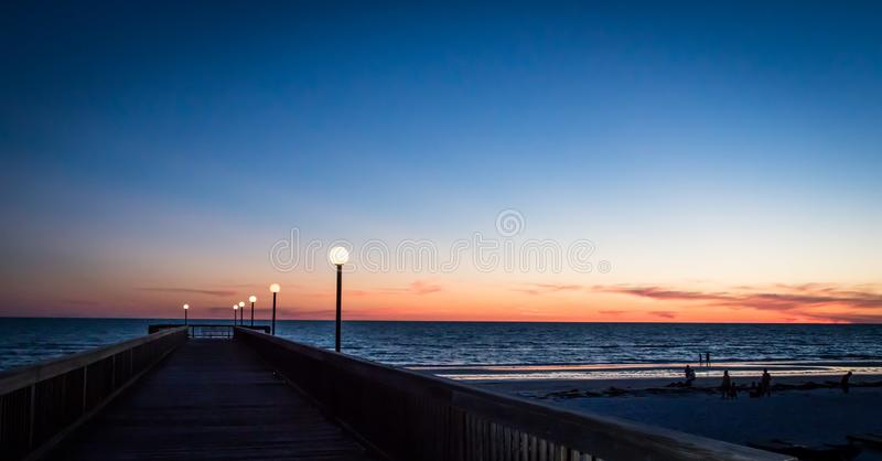 Beautiful sunset in clearwater beach. With blue and orange colors royalty free stock photo