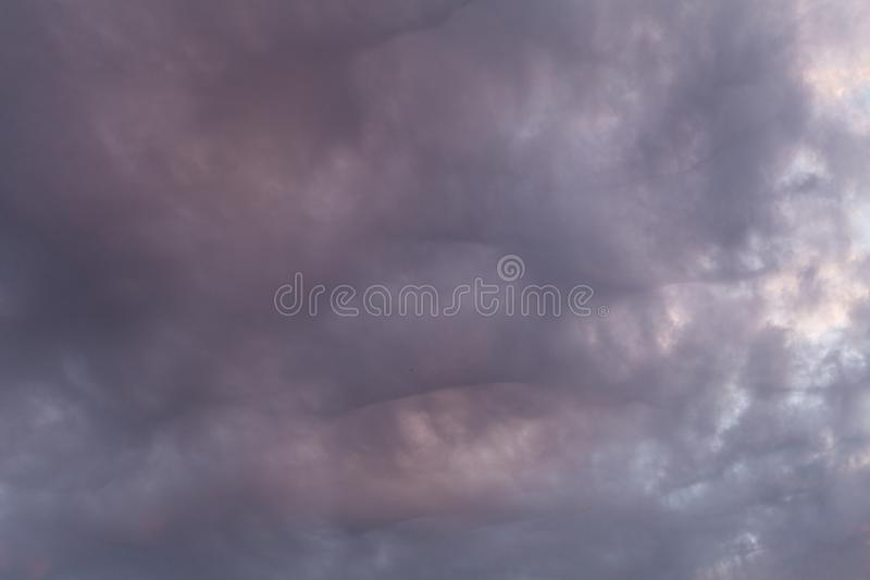 Beautiful sunset on clouds. Beautiful sunset on dark clouds stock images