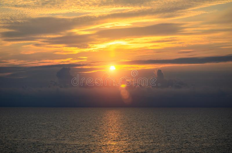Beautiful sunset with clouds over the sea.  royalty free stock photos