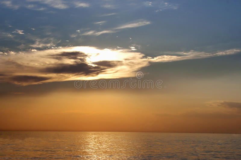 Beautiful sunset with clouds over sea. Beautiful sunset with clouds over the sea stock photos