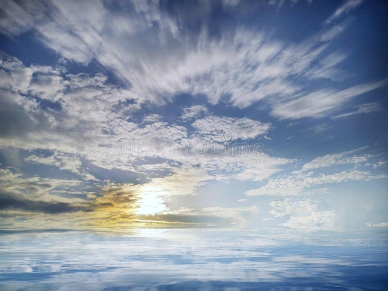 Beautiful sunset with clouds in sea reflection stock photography