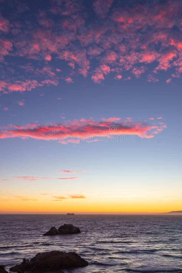 Beautiful sunset on the coast of San Francisco with powdery pink clouds in the sky. San Francisco, California stock images