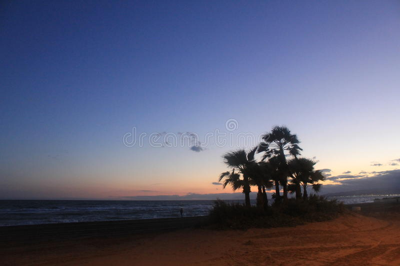 A beautiful sunset at the coast in Torrox Costa, Spain royalty free stock image