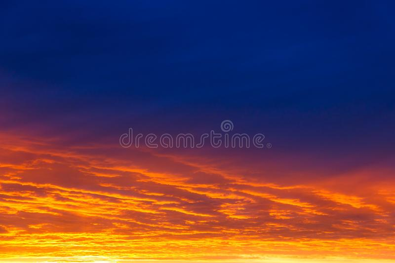 Beautiful sunset. Colorful dramatic sky at sunset. Layered rain clouds. Bright blue orange background stock images