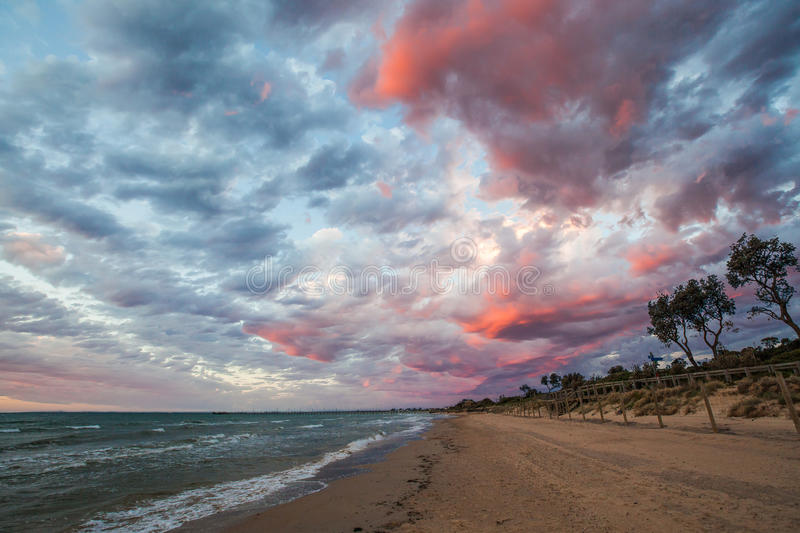 Beautiful Sunset colors over coulds on the beach. Mornington Peninsula, Victoria, Australia royalty free stock photos
