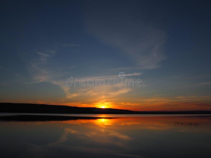Beautiful sunset colours under lake royalty free stock photos