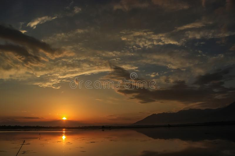 A beautiful sunset on the Dal Lake in Kashmir. Reflections in the Dal Lake stock photography