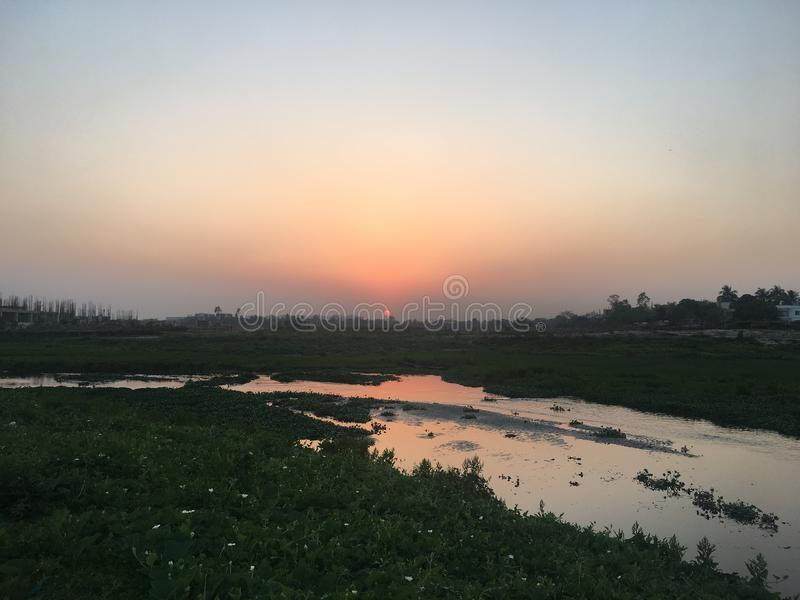 Beautiful sunset, Dhaka, Bangladesh. It's suburb, rural area royalty free stock image