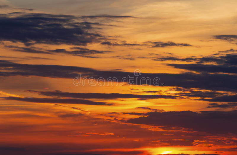 Beautiful sunset with dramatic clouds. On the sky stock photos