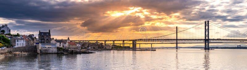Beautiful sunset at The Forth road bridge and Queensferry crossing bridge Edinburgh. Panorama of beautiful sunset at The Forth road bridge and Queensferry royalty free stock photos