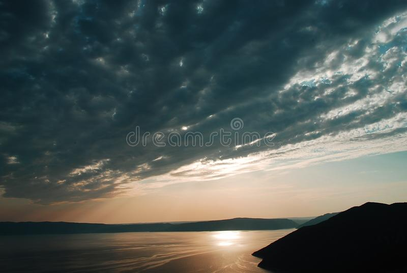 A beautiful sunset in front of the island of Cres, Croatia. Discovering the beautiful Croatia, an enchanting country stock image