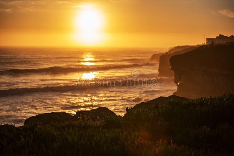 Beautiful sunset in the golden sky over the ocean in Santa Cruz California royalty free stock image