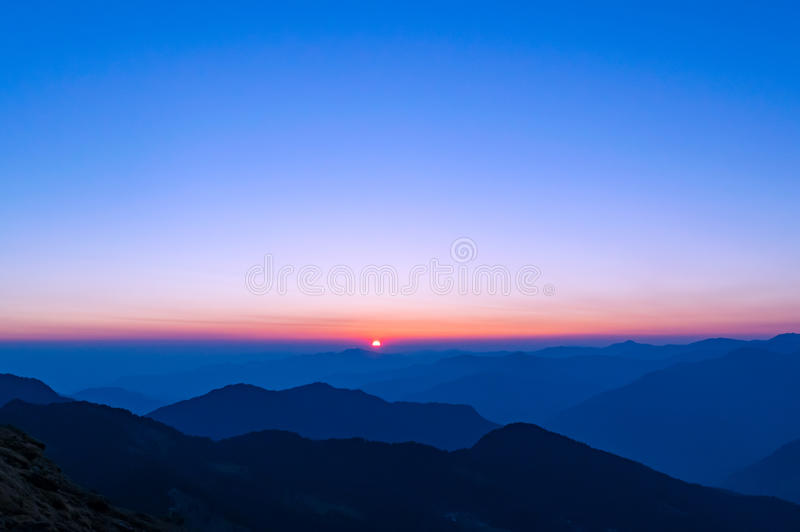 Beautiful sunset in Himalayas. Sunset in Garhwal Himalayas in Autumn from Tungnath trail. Kedarnath wildlife sanctuary nestled in these mountains near Chopta in stock photos