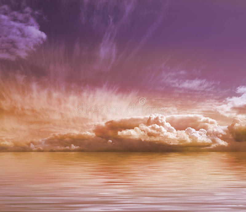 A beautiful sunset image with deep sky and water. A beautiful sunset image with violet and orange sky, clouds and water. Taken during the summer royalty free stock image