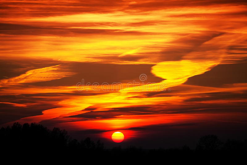 Beautiful sunset with intense and dramatic colors of clouds.  royalty free stock photos
