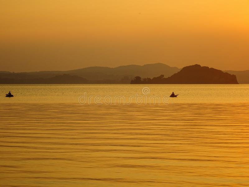 Sunset in bolsena lake, with sailors. Beautiful sunset in Italy bolsena lake sailora royalty free stock image