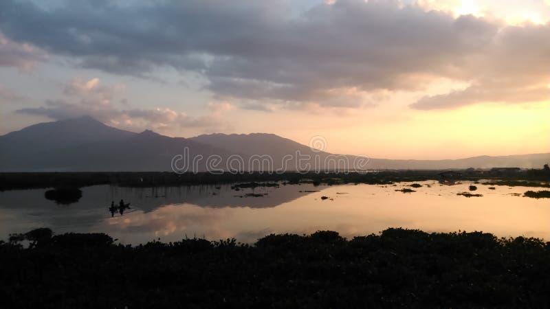 Beautiful sunset at lake and mountain royalty free stock photography