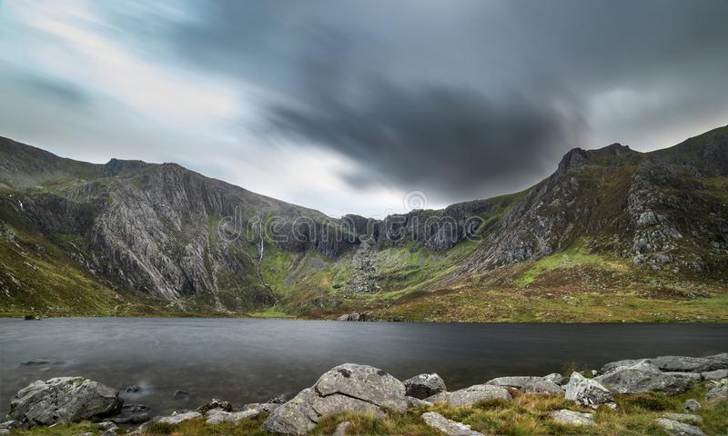 Beautiful sunset landscape image of Llyn Idwal and Devil`s Kitch royalty free stock images