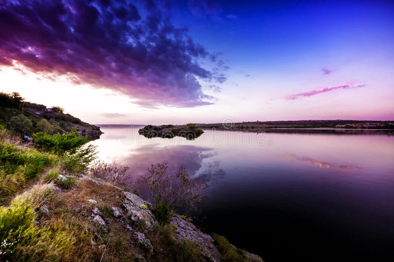 Beautiful sunset landscape on river. Clouds at sunset royalty free stock photos