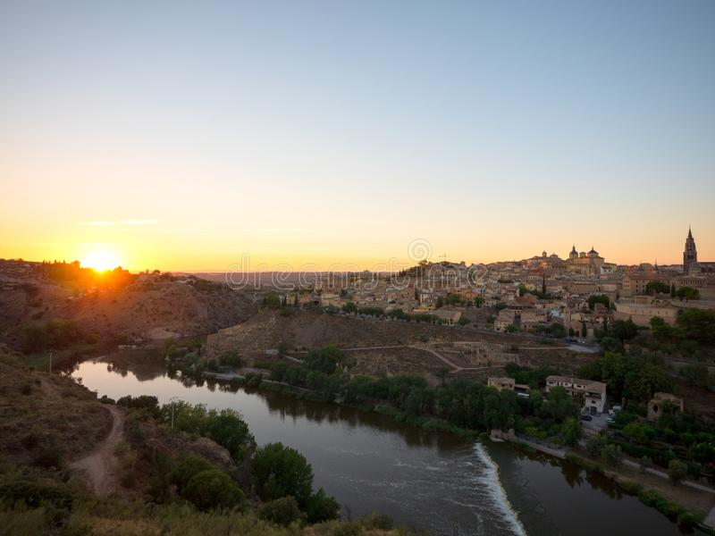 Beautiful sunset landscape of Toledo old town and river Tajo royalty free stock photo