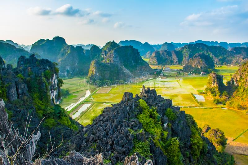 Beautiful sunset landscape viewpoint with green rice fields from the top of Mua Cave mountain, Ninh Binh, Tam Coc, Vietnam royalty free stock photos