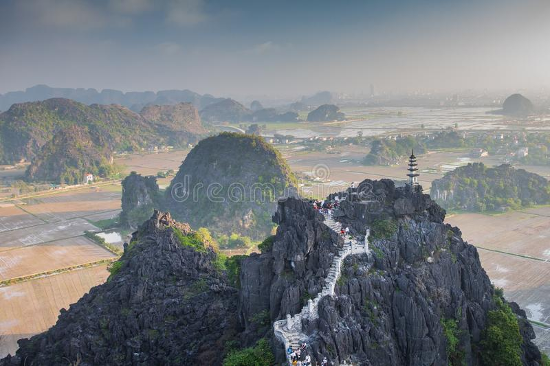 Beautiful sunset landscape viewpoint with white stupa from the top of Mua Cave mountain, Ninh Binh, Tam Coc, Vietnam. Beautiful sunset landscape viewpoint with royalty free stock image