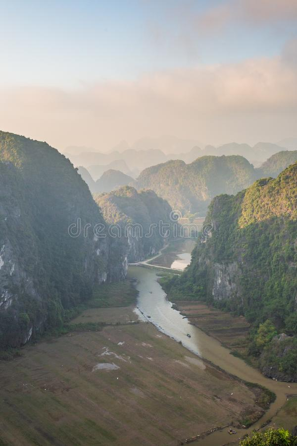 Beautiful sunset landscape viewpoint with white stupa from the top of Mua Cave mountain, Ninh Binh, Tam Coc, Vietnam. Beautiful sunset landscape viewpoint with royalty free stock photos