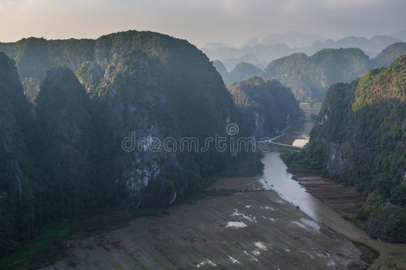 Beautiful sunset landscape viewpoint with white stupa from the top of Mua Cave mountain, Ninh Binh, Tam Coc, Vietnam. Beautiful sunset landscape viewpoint with royalty free stock photo