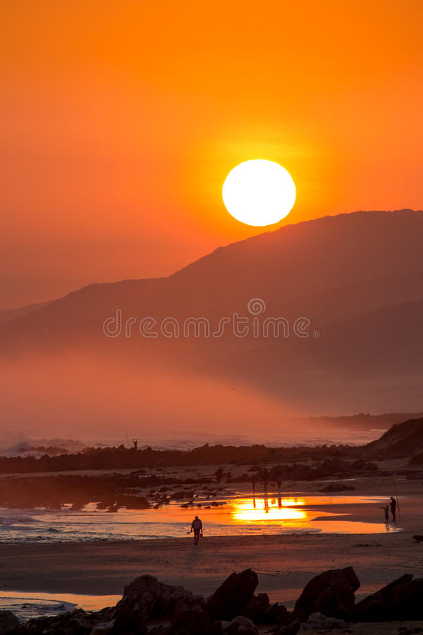 Download Beautiful Sunset With Large Round Sun Stock Photo