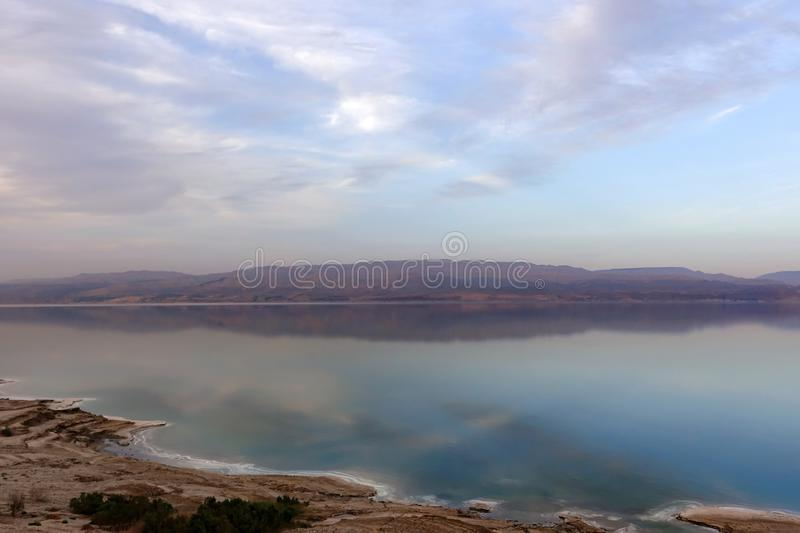 Beautiful sunset in lilac tones over the dead sea. View from Israel coast to Jordan side royalty free stock photos