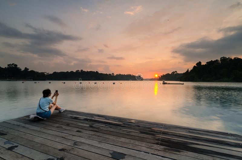 Beautiful sunset at MacRitchie Reservoir. Singapore, 31 Mar 2018: Beautiful sunset at MacRitchie Reservoir which is Singapore`s oldest reservoir completed in royalty free stock image
