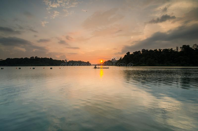 Beautiful sunset at MacRitchie Reservoir. Singapore, 31 Mar 2018: Beautiful sunset at MacRitchie Reservoir which is Singapore`s oldest reservoir completed in stock image
