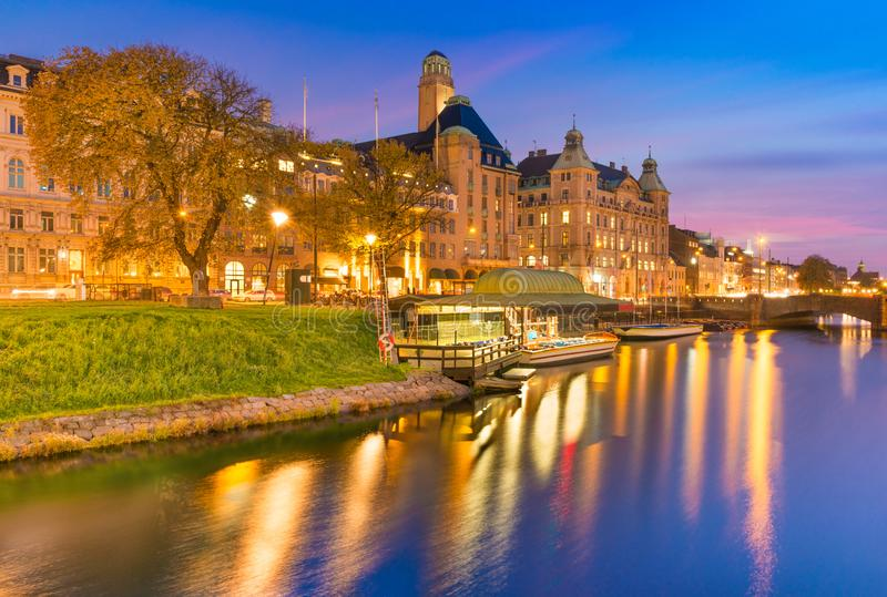 Beautiful sunset in Malmo, Sweden. Picturesque evening cityscape. Old historical buildings, canal with boats royalty free stock photography
