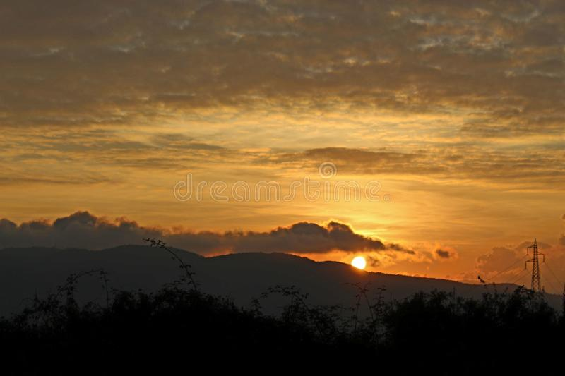 The beautiful sunset in the mountains. Today it was a sunny day with later in the afternoon a nice sunset. This sunset is in the mountains in Fosdinovo in Italy stock photo