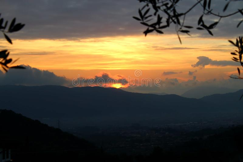 The beautiful sunset in the mountains. Today it was a sunny day with later in the afternoon a nice sunset. This sunset is in the mountains in Fosdinovo in Italy royalty free stock photo
