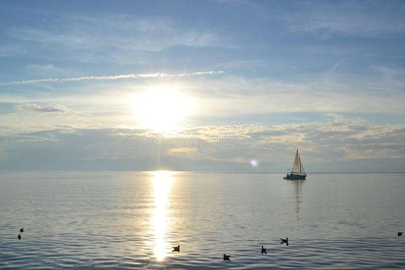 Beautiful sunset by the Ohrid Lake. Sailing in the Ohrid Lake stock photos