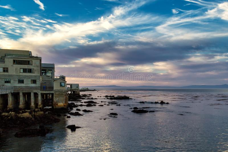 Beautiful sunset and old coastal buildings in Monterey, California royalty free stock photo
