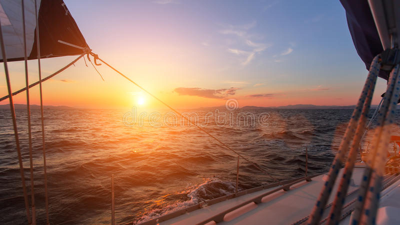 Beautiful sunset in the open sea with sailing yacht. Travel. Beautiful sunset in the open sea with sailing yacht stock photography