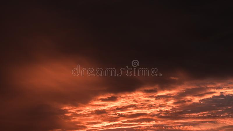 Sunset. Orange sky in the clouds stock photo