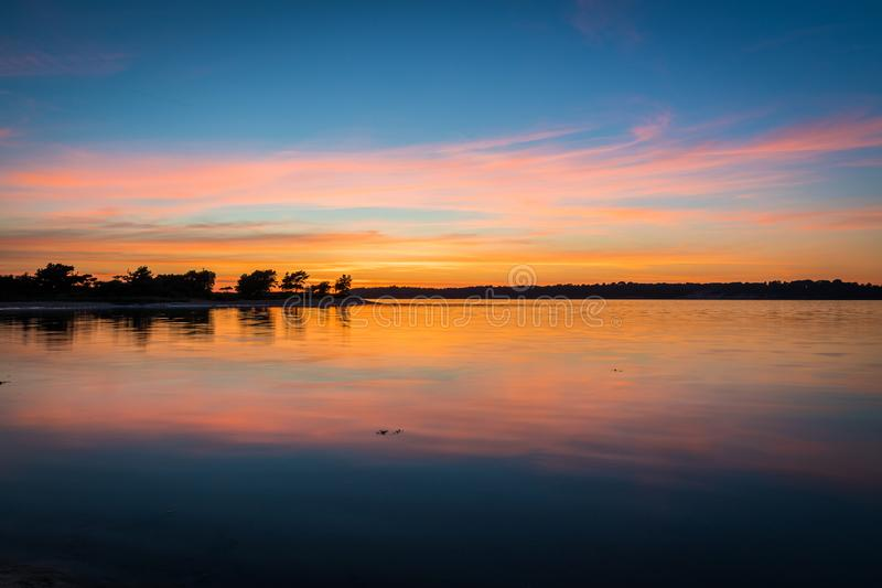 Beautiful sunset over bay with reflections royalty free stock image